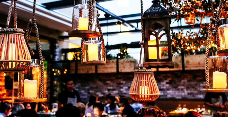 Lamps hanging over diners at Herringbone