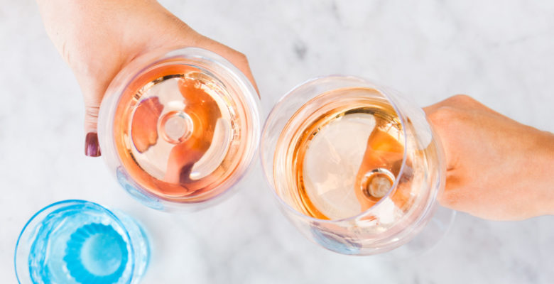 Two glasses of rose toasting